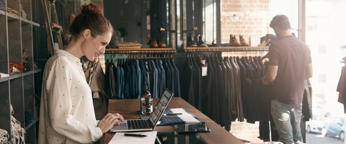 Key Trends | Apparel Store Clerk on Laptop