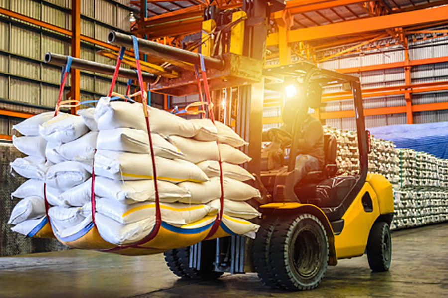 Forklift Transporting Bags of Rice